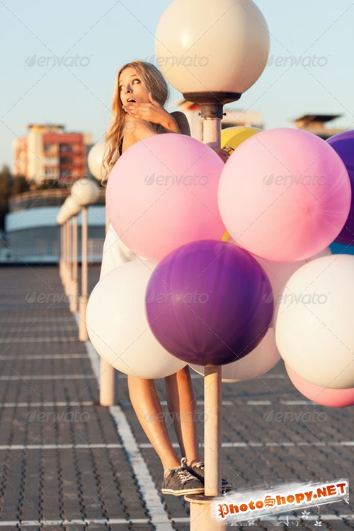 PhotoDune Happy young woman with colorful latex balloons 6308990